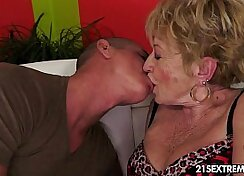 Big breasted hottie grandmother rides younger cock
