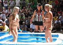 Amateur couple film themselves playing with oil wrestling